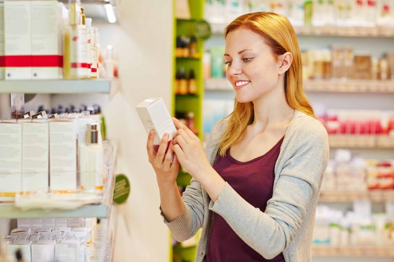 woman shopping for care products in pharmacy