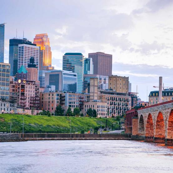 View of Minneapolis skyline and bridge over water